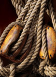 Nautical ropes and pulleys. Nautical ropes and wooden pulleys stock images