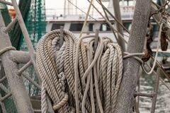 Nautical ropes ready for use on deck of a commercial fishing boat close up