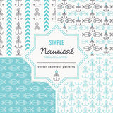 Nautical seamless patterns with outlined holiday and winter signs. Stock Photos