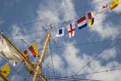 Nautical signal. Flags in the sky Stock Image