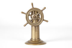 Nautical steering wheel. Miniature nautical steering wheel isolated on white background Royalty Free Stock Image