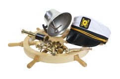 Nautical Supplies. Including ship wheel, captain hat, bell, and an assortment of brass instruments - path included Stock Photos