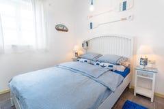 Nautical themed boy hotel bedroom royalty free stock photos