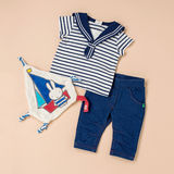 Nautical Themed Toddler Outfit on Beige Surface Royalty Free Stock Photos