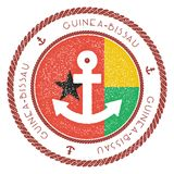 Nautical Travel Stamp with Guinea-Bissau Flag and. Nautical Travel Stamp with Guinea-Bissau Flag and Anchor. Marine rubber stamp, with round rope border and Royalty Free Stock Photography