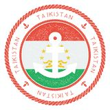 Nautical Travel Stamp with Tajikistan Flag and. Nautical Travel Stamp with Tajikistan Flag and Anchor. Marine rubber stamp, with round rope border and anchor Stock Photography