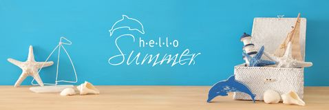 Nautical, vacation and travel banner with sea life style objects over wooden table. Nautical, vacation and travel banner with sea life style objects over wooden Stock Photo