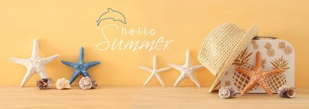 Nautical, vacation and travel banner with sea life style objects over wooden table. Nautical, vacation and travel banner with sea life style objects over wooden Royalty Free Stock Photos