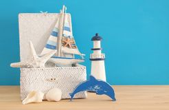 Nautical, vacation and travel image with sea life style objects over wooden table. Nautical, vacation and travel image with sea life style objects over wooden Stock Photography