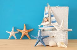 Nautical, vacation and travel image with sea life style objects over wooden table. Nautical, vacation and travel image with sea life style objects over wooden Stock Images