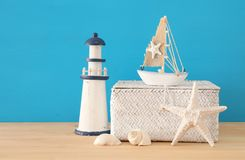 Nautical, vacation and travel image with sea life style objects over wooden table. Nautical, vacation and travel image with sea life style objects over wooden Royalty Free Stock Images