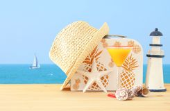 Nautical, vacation and travel image with sea life style objects over wooden table. Nautical, vacation and travel image with sea life style objects over wooden Royalty Free Stock Photography