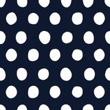 Nautical vector seamless pattern with classic white hand drawn polka dots on a dark navy blue background vector illustration
