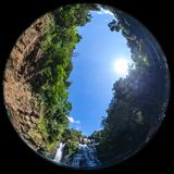 Nauyaca Falls, Costa Rica. Nauyaca waterfalls with a deep swimming hole and large rocks in the south pacific of Costa Rica, shot with a fish eye lens for a Royalty Free Stock Photography