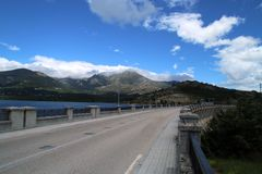 Navacerradas dam and its road on the top of the wall. royalty free stock photo