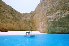 Navagio Bay - Zakynthos. Wreck Bay (Navagio) on Zakynthos Island - Greece. Blue sea, rocks, yacht and white sandy beach Stock Photos