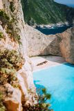Navagio beach. Pure turquoise azure cyan teal blue sea water surrounded by huge white limestone cliffs. Famous Zakynthos. Landmark, Greece stock image