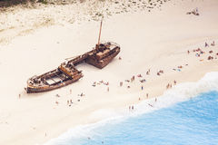 Navagio shipwreck. People sunbathing at Navagio Beach, Zakynthos Royalty Free Stock Photos