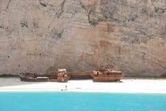 Navagio - Zakynthos island blue sea beach greece. Wreck Bay on Zakynthos Island - Greece. Blue sea, yacht and white sandy beach Royalty Free Stock Photo