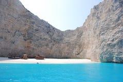 Navagio - Zakynthos island blue sea beach greece. Wreck Bay on Zakynthos Island - Greece. Blue sea, yacht and white sandy beach Stock Photo