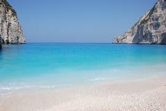 Navagio - Zakynthos island blue sea beach greece. Wreck Bay on Zakynthos Island - Greece. Blue sea, yacht and white sandy beach Stock Images