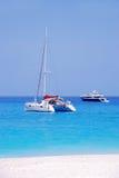 Navagio - Zakynthos island blue sea beach greece. Wreck Bay on Zakynthos Island - Greece. Blue sea, yacht and white sandy beach Royalty Free Stock Images