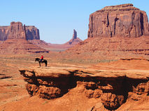 Navajo à cheval en vallée Arizona de monument Photos libres de droits