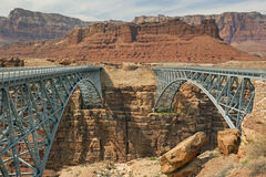Navajo Bridge. And the old  crossing the Colorado River's Marble Canyon near Lee's Ferry in Arizona royalty free stock photo