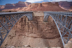 Navajo Bridge. These two bridges, one historic and one new, represent one of only seven land crossings of the Colorado River for 750 miles (1207 km stock image