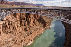 Navajo Bridge. These two bridges, one historic and one new, represent one of only seven land crossings of the Colorado River for 750 miles (1207 km royalty free stock photos