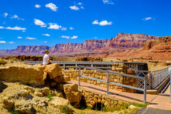 Navajo Bridge Arizona. Marble Canyon, Arizona - April 19, 2017: Visitor enoying the scenic Navajo bridge over the Colorado River Royalty Free Stock Photos