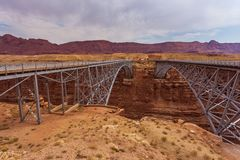 Historic Navajo Bridge spans Marble Canyon in northern Arizona. royalty free stock images