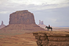 Navajo Horsewoman in Monument Valley. A navajo woman on horseback in scenic landscape of monument valley tribal park stock photos
