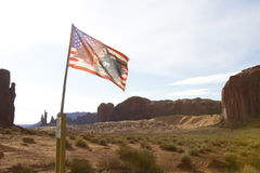Navajo Nation Flag with Rock Mesas Stock Photo