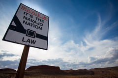 Navajo nation state law sign with wild landscape. Navajo sign saying Buckle up - it's a Navajo Nation Law - against the sky Stock Photo