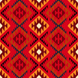 Navajo tribal ornament. Vector seamless ethnic pattern with american indian motifs in multiple colors. Colorful aztec background. Textile print with navajo Royalty Free Stock Images