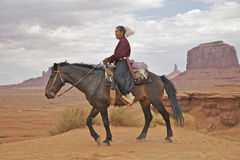 Navajo Woman at Monument Valley. A navajo woman on horseback in scenic landscape of monument valley tribal park Royalty Free Stock Image
