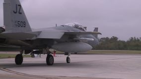 Naval Air Station New Orleans, November 2015, Two. Two F15 jet aircraft roll to the rollfield stock footage
