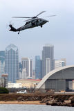 Naval Base San Diego. A helicopter lands at the Naval Base in San Diego. This is the largest Naval Base on the West Coast of the United States. The San Diego royalty free stock images