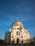 Naval cathedral of Saint Nicholas in Kronstadt, view from the main entrance, the temple is illuminated by the setting sun Stock Photos