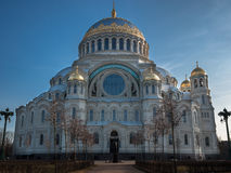Naval cathedral of Saint Nicholas in Kronstadt, view from the main entrance, the temple is illuminated by the setting sun Stock Photography