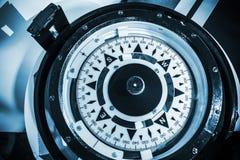 Naval compass. Blue toned close-up photo Stock Photos