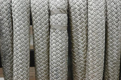 Naval cordage close-up. Coils of gray braided rope at the dock in close-up Stock Photography