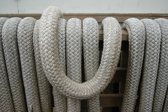 Naval cordage close-up. Coils of gray braided rope at the dock in close-up Royalty Free Stock Photos