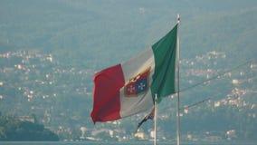 Naval ensign of Italy. Italian flag, Stresa town background. European citizenship program stock video