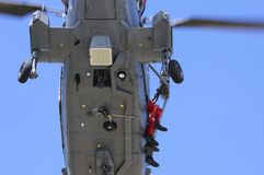 Naval helicopter on a rscue mission Stock Images