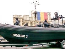 Naval man in boat Stock Image