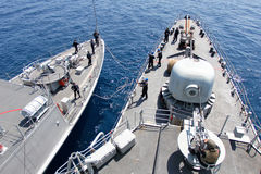 Naval maneuvers on deck. Two spanish military marine ships bows with operators maneuvering during a Nato coordinate simulation between many warships in Balearic stock photos