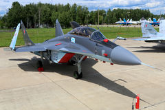 Naval MiG-29K 39 BLUE standing at Kubinka air force base during Army-2015 forum. KUBINKA, MOSCOW REGION, RUSSIA - JUNE 17, 2015: Naval MiG-29K 39 BLUE standing Stock Photos