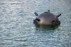 Naval mine. The big black sea surface mine Royalty Free Stock Photography